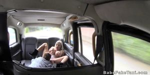 Monster tits blonde rides in female fake taxi