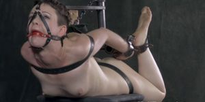 Suspended bondage sub pussy stimulated with toys