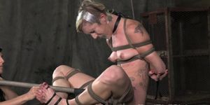 Lezdom ballgagged sub gets clit paddled