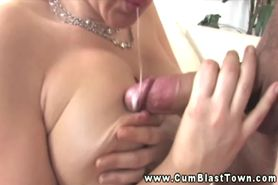 Blonde busty MILF enjoys giving handjobs