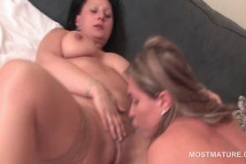 Hot mature lesbian fucking GFs cunt with her moist fing