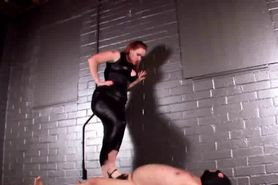 Redhead mistress torturing cock in BDSM video
