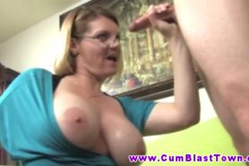 Big tit mature amateur tugging on cock
