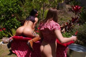 Lesbo hotties enjoy outdoor milk enemas