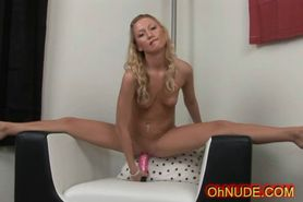 Very cute blonde rides her pink dildo