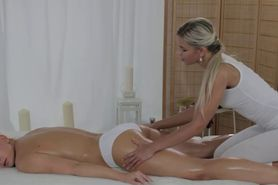 Lesbian masseuse fingers her customer on a table