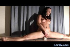 Brunette opens legs wide with dildo