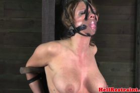 Gagged sub spanked while restrained