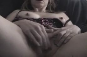 Mature wife fingers her cunt close Up