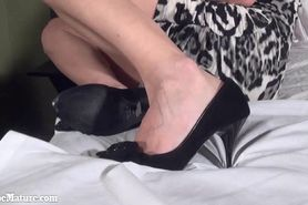 Sexy Mom does striptease in the bed in striped clothes