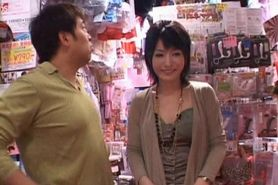 Japanese stunner gets hairy twat vibed in a sex shop