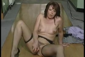 MILF Strips And Masturbates