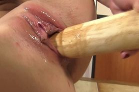 Blond babes gaping pussy takes the bat in her pussy