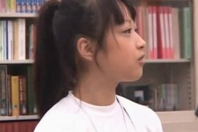 Cute asian teen girl teased in the school library