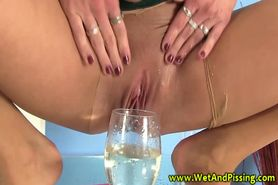 Piss: Redhead fetish drinking her piss after using toy