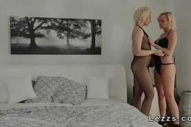 Blonde lesbians with strapon fucking in bed