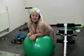 Chubby Grandma does strip in home gym