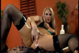 Slippery blonde in fishnet thigh highs fucking