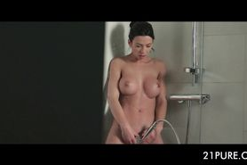 Teen horny beauty finger fucking her pussy under shower