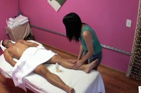 Sensual asian masseuse gives client head