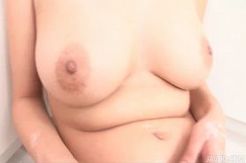 Milk covered HInano fondles her big tits and toys her p