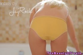 Petite blonde teen plays with toothbrush