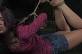 Hogtied sub punished with wooden cane