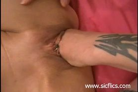 Her loose pussy gets a huge fist fucking