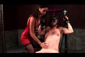 Mistress in latex torturing her chained slave