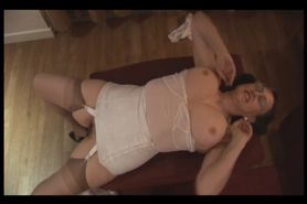 Busty hairy mature brunette in slip and corsette