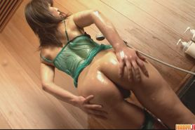 Big ass and oiled up brunette