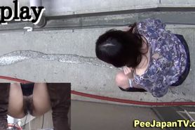 Asians pee in alley way