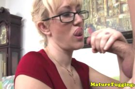 Big titted cougar plays with cock