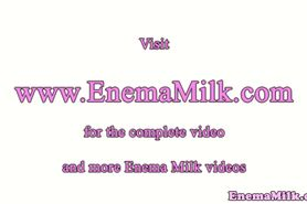 Tattooed milk enema squirting lesbos fun