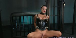 Busty mistress in corset fucks male sub in dungeon