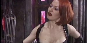 Ginger mistress whipping her blonde male slave