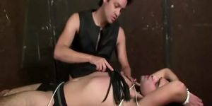 Dominant master using leather whip on his pathetic sub