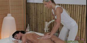 Hot blonde masseuse massages nude brunette