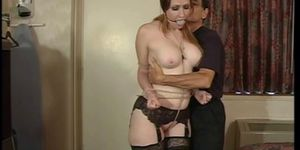 Julie Simone in nylons gets her big tits teased by her