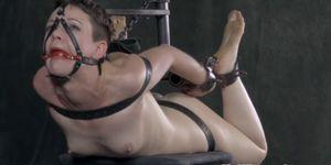 Suspended bondage sub pussy stimulated with toys