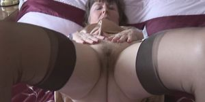 Hairy granny in slip and stockings with see through pan