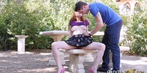 Kinky redhead gets banged under the bright yellow sun