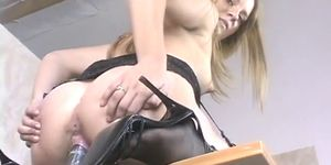 Teen Plays With A Dildo At Her Desk