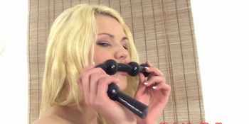 Puffy peach teen hottie plays with toys