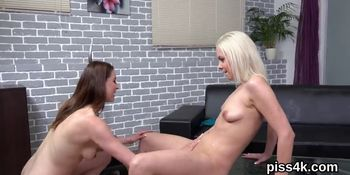 Kissable lesbian teenies get covered with piss