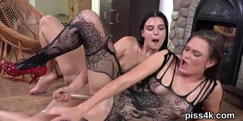 Sultry lesbian kittens get sprayed with urine and ejacu