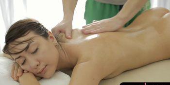 Brunette client gets banged by masseur on massage table