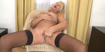 Blonde granny masturbate on the chair in livingroom