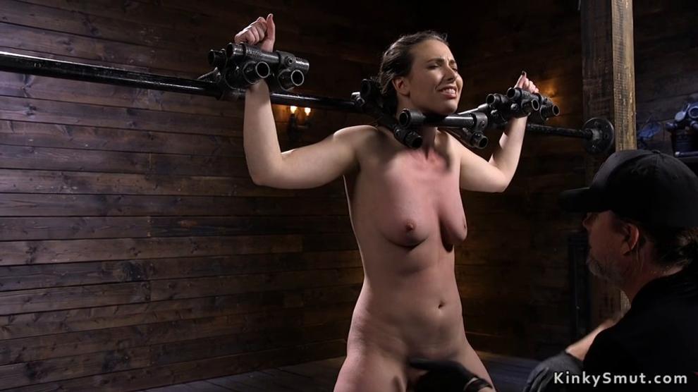 Blindfolded brunette caned in bondage