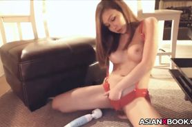 Beautiful asian babe with her toy